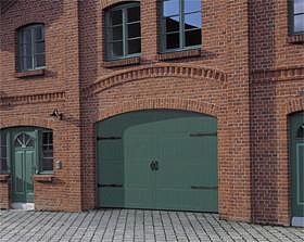 Timber sectional garage door with routed design and green factory finish