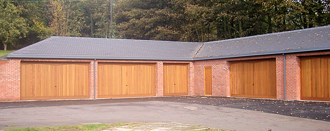 5 car garage with timber up and over doors