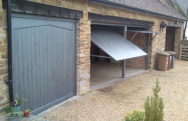 triple garage with Woodrite timber up and over doors
